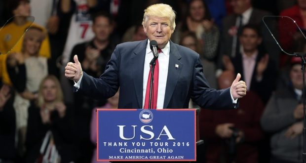 epa05655888 US President-elect Donald Trump speaks during the first stop of his 'USA Thank You Tour 2016' rally at US Bank Arena in Cincinnati, Ohio, USA, 01 December 2016.  EPA/MARK LYONS